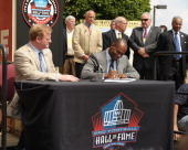 Commissioner of the National Football League Roger Goodell and Director of the National Football League Players' Association DeMaurice Smith sign the...