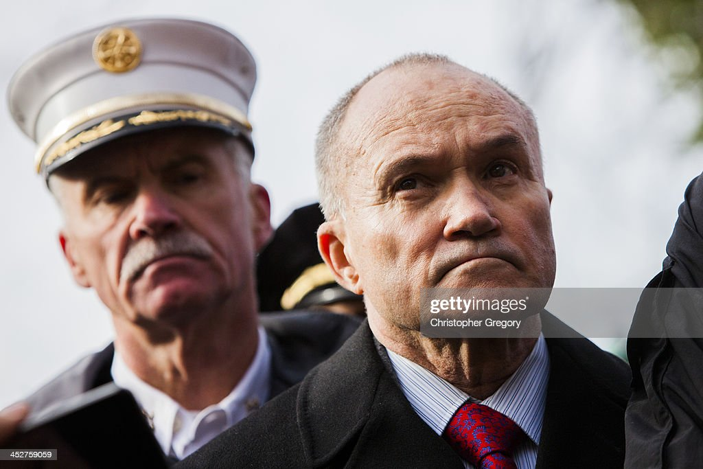 Commissioner of the New York City Police Department (NYPD) Ray Kelly (R) speaks to the media as Fire Department of New York (FDNY) Chief Edward Kilduff looks on after Metro-North train derailed near the Spuyten Duyvil station December 1, 2013 in the Bronx borough of New York City. Multiple injuries and several deaths were reported after the seven car train left the tracks as it was heading to Grand Central Terminal along the Hudson River line.