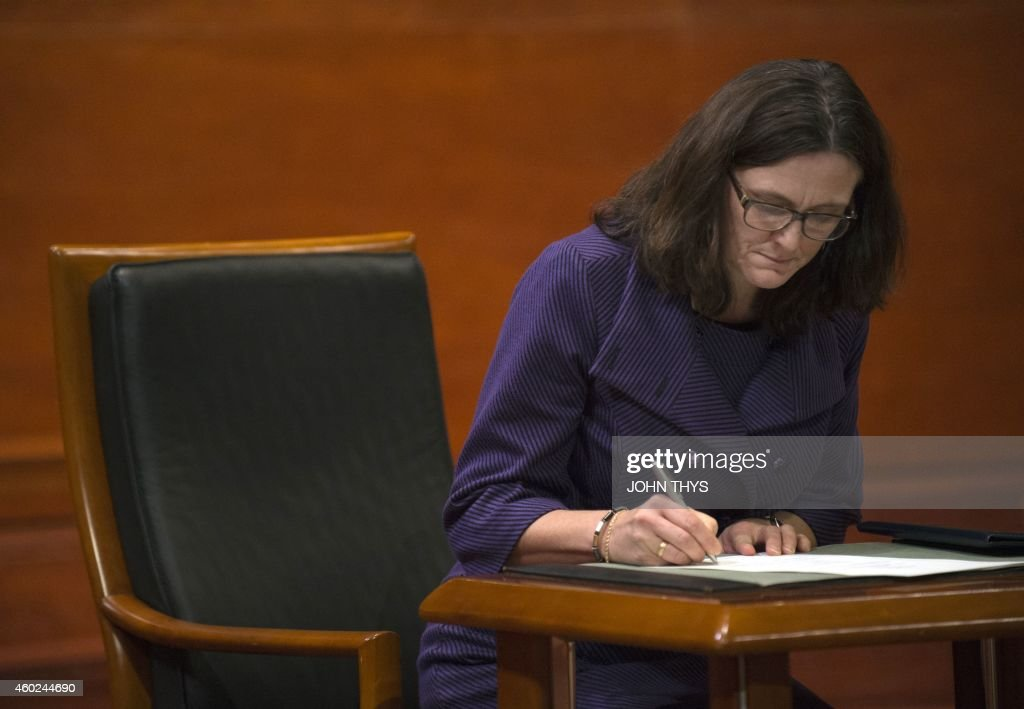 EU Commissioner of Trade Cecilia Malmstrom, signs after taking the oath of office, on December 10, 2014 at the Court of Justice of the European Union in Luxembourg. AFP PHOTO / JOHN THYS.