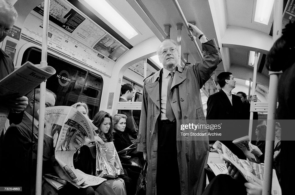 Commissioner of Transport for London, Bob Kiley on his way to work on board a crowded tube train.