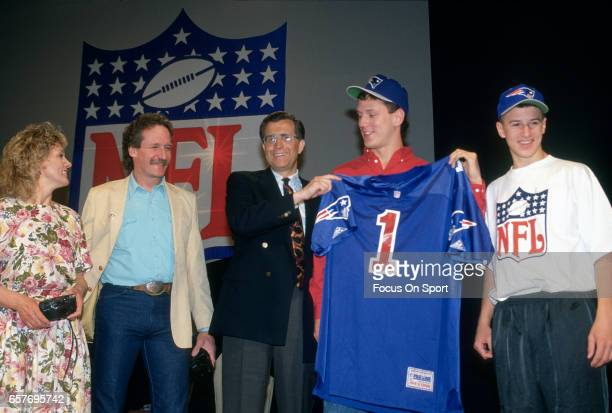 Commissioner Paul Tagliabue stands with Drew Bledsoe the number 1 draft pick of the New England Patriots in the 1993 NFL draft April 25 1993 at the...