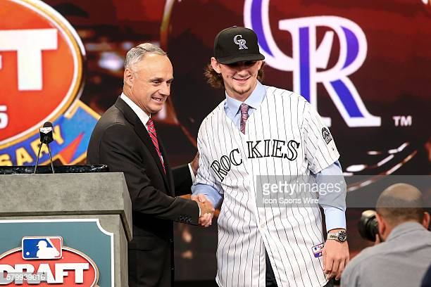 Commissioner Rob Manfred poses for photos with Brendan Rodgers Shortstop from Lake Mary High School in Florida chosen by the Colorado Rockies with...