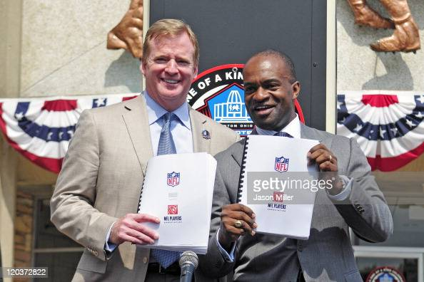 Commissioner Roger Goodell and NFLPA Executive Director Demaurice Smith hold up the NFL's new 10year Collective Bargaining Agreement at the Pro...