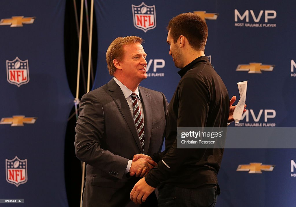 NFL Commissioner Roger Goodell and quarterback Joe Flacco of the Baltimore Ravens shakes hands during the Super Bowl XLVII Team Winning Coach and MVP Press Conference at the Ernest N. Morial Convention Center on February 4, 2013 in New Orleans, Louisiana.