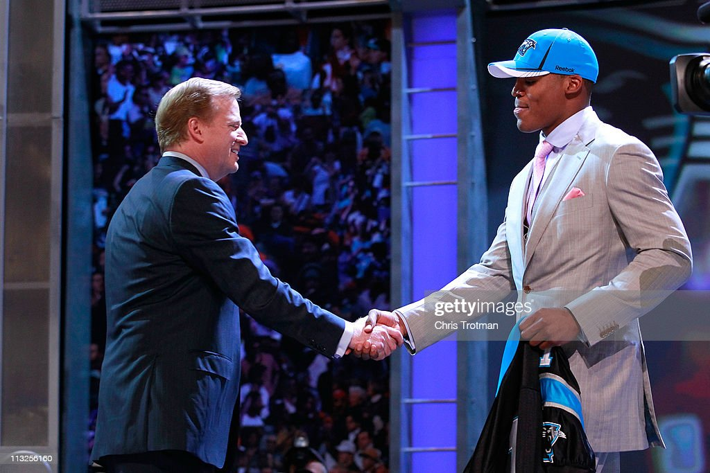 Commissioner <a gi-track='captionPersonalityLinkClicked' href=/galleries/search?phrase=Roger+Goodell&family=editorial&specificpeople=744758 ng-click='$event.stopPropagation()'>Roger Goodell</a> greets Carolina Panthers #1 overall pick <a gi-track='captionPersonalityLinkClicked' href=/galleries/search?phrase=Cam+Newton+-+American+Football+Quarterback&family=editorial&specificpeople=4516761 ng-click='$event.stopPropagation()'>Cam Newton</a> from the Auburn during the 2011 NFL Draft at Radio City Music Hall on April 28, 2011 in New York City.