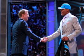 Commissioner Roger Goodell greets Carolina Panthers overall pick Cam Newton from the Auburn during the 2011 NFL Draft at Radio City Music Hall on...