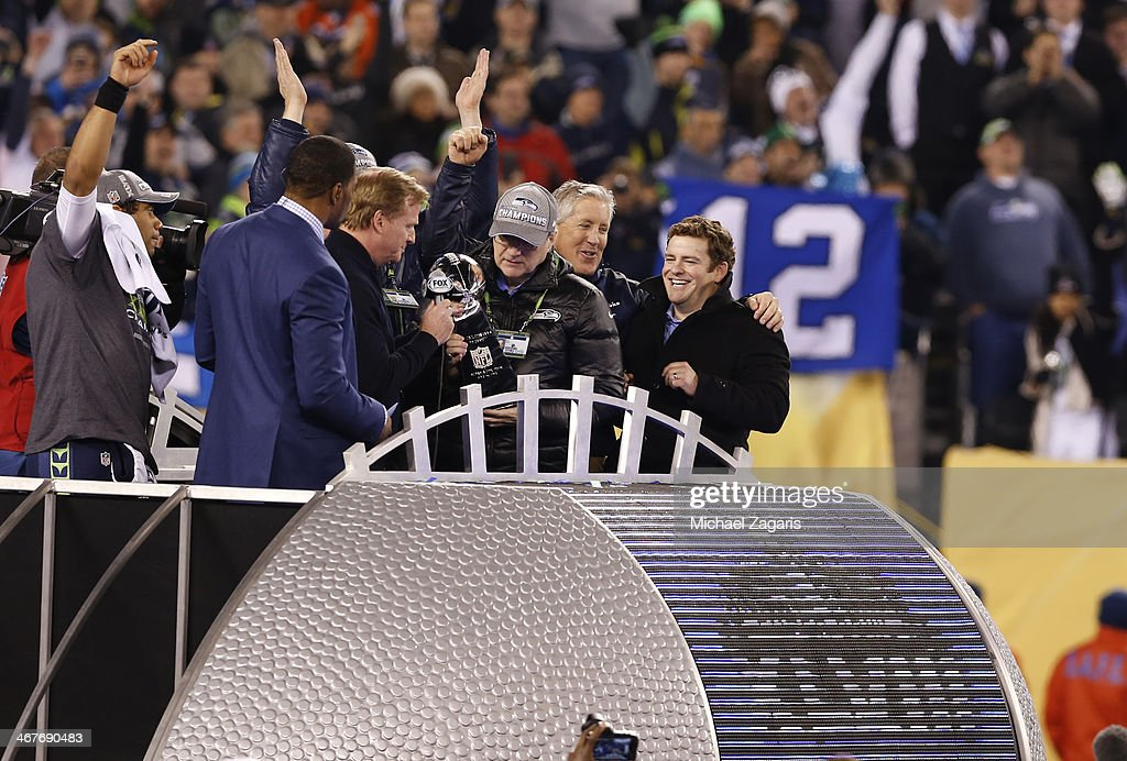 Commissioner Roger Goodell hands the Super Bowl Trophy to Owner Paul Allen of the Seattle Seahawks during the trophy ceremony following Super Bowl XLVIII against the Denver Broncos at MetLife Stadium on February 2, 2014 in East Rutherford, New Jersey.