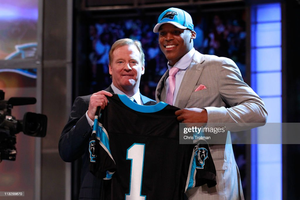 COmmissioner <a gi-track='captionPersonalityLinkClicked' href=/galleries/search?phrase=Roger+Goodell&family=editorial&specificpeople=744758 ng-click='$event.stopPropagation()'>Roger Goodell</a> poses for a photo with Carolina Panthers #1 overall pick <a gi-track='captionPersonalityLinkClicked' href=/galleries/search?phrase=Cam+Newton+-+American+Football+Quarterback&family=editorial&specificpeople=4516761 ng-click='$event.stopPropagation()'>Cam Newton</a> from the UNiversity of Auburn during the 2011 NFL Draft at Radio City Music Hall on April 28, 2011 in New York City.