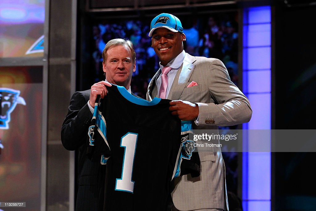 COmmissioner <a gi-track='captionPersonalityLinkClicked' href=/galleries/search?phrase=Roger+Goodell&family=editorial&specificpeople=744758 ng-click='$event.stopPropagation()'>Roger Goodell</a> poses for a photo with Carolina Panthers #1 overall pick <a gi-track='captionPersonalityLinkClicked' href=/galleries/search?phrase=Cam+Newton+-+American+Football+Quarterback&family=editorial&specificpeople=4516761 ng-click='$event.stopPropagation()'>Cam Newton</a> from Auburn during the 2011 NFL Draft at Radio City Music Hall on April 28, 2011 in New York City.