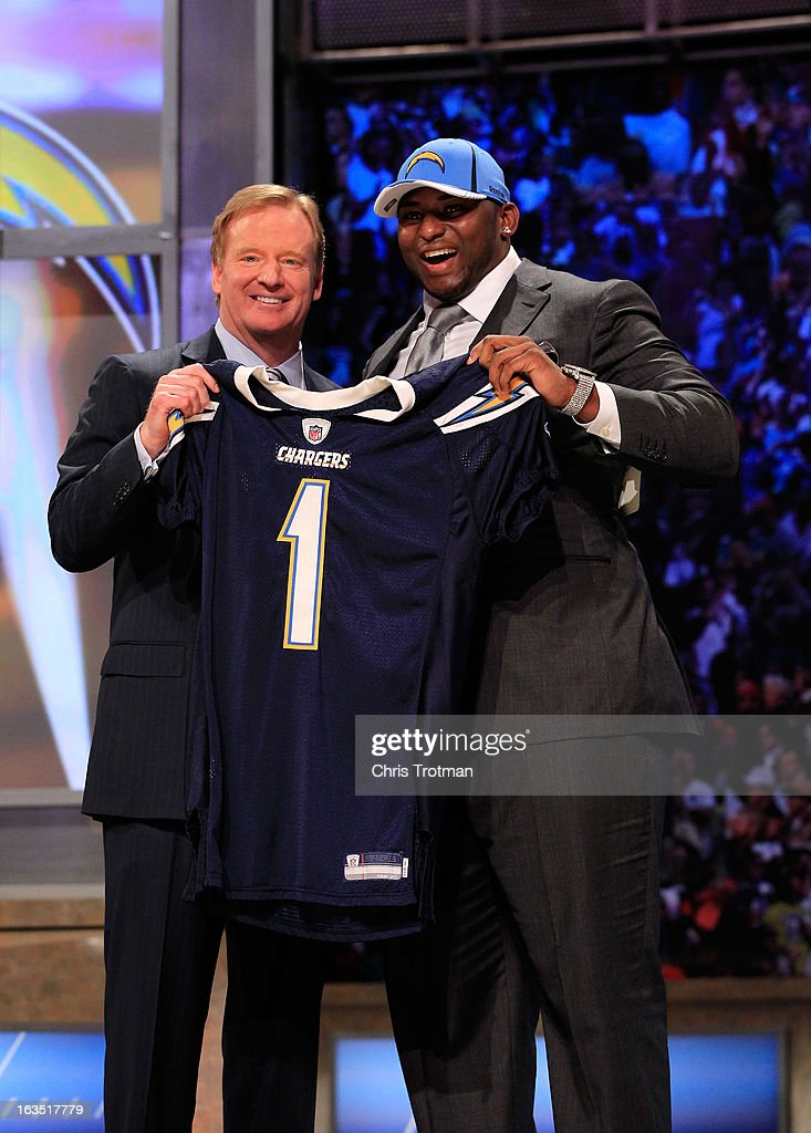 Commissioner <a gi-track='captionPersonalityLinkClicked' href=/galleries/search?phrase=Roger+Goodell&family=editorial&specificpeople=744758 ng-click='$event.stopPropagation()'>Roger Goodell</a> (L) poses for a photo with <a gi-track='captionPersonalityLinkClicked' href=/galleries/search?phrase=Corey+Liuget&family=editorial&specificpeople=5533751 ng-click='$event.stopPropagation()'>Corey Liuget</a>, #18 overall pick by the San Diego Chargers, on stage during the 2011 NFL Draft at Radio City Music Hall on April 28, 2011 in New York City.
