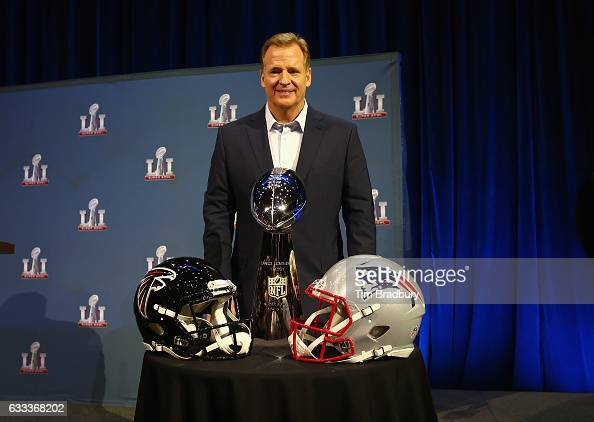 Commissioner Roger Goodell poses with the Vince Lombardi Trophy after speaking with the media during a press conference for Super Bowl 51 at the...