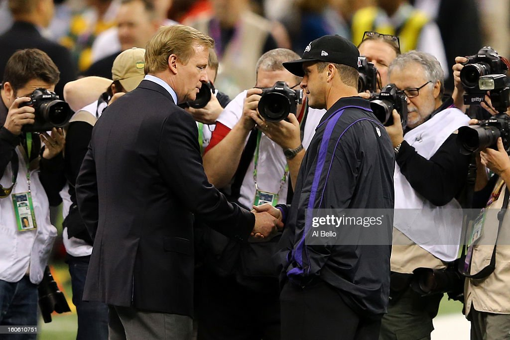 NFL Commissioner Roger Goodell (L) shakes hands with head coach John Harbaugh of the Baltimore Ravens prior to Super Bowl XLVII between the San Francisco 49ers and Baltimore Ravens at the Mercedes-Benz Superdome on February 3, 2013 in New Orleans, Louisiana.