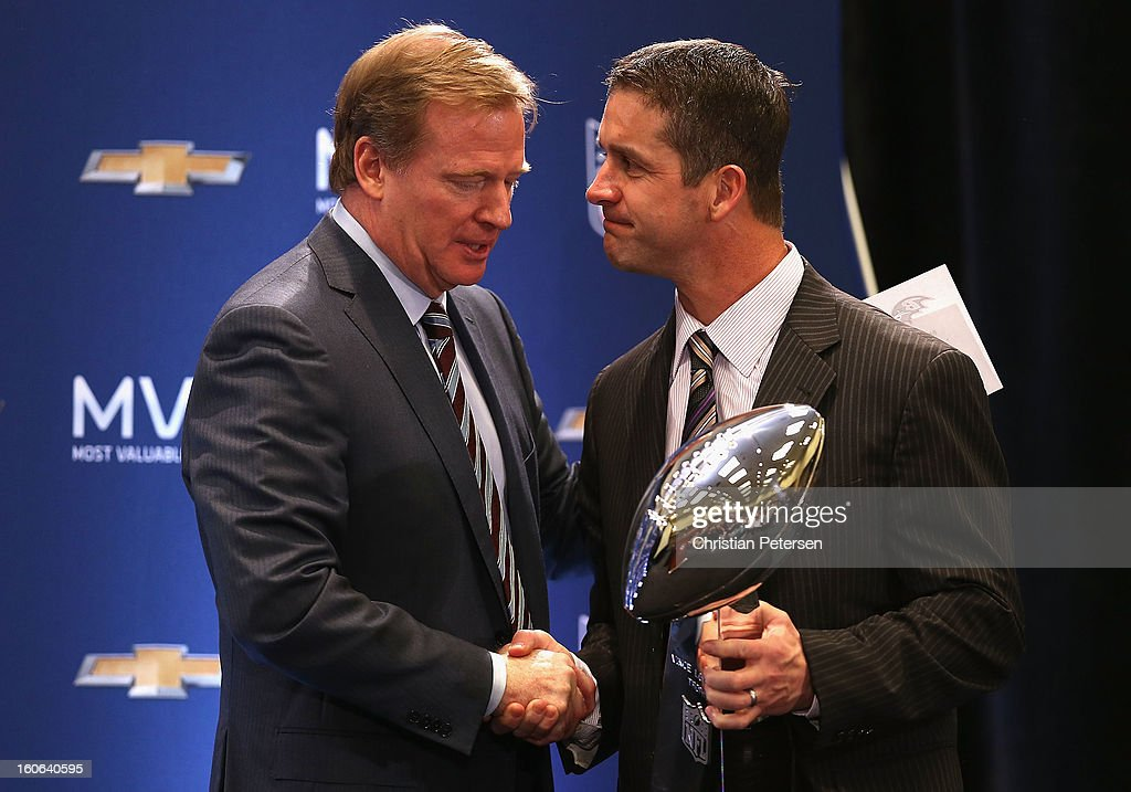 NFL Commissioner Roger Goodell shakes hands with head coach John Harbaugh of the Baltimore Ravens during the Super Bowl XLVII Team Winning Coach and MVP Press Conference at the Ernest N. Morial Convention Center on February 4, 2013 in New Orleans, Louisiana.