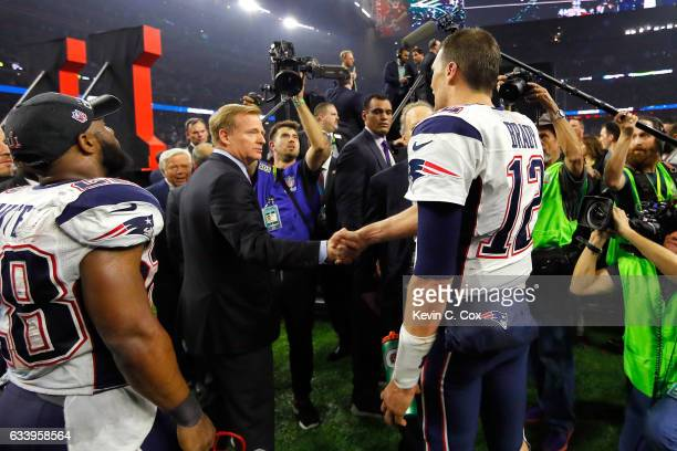 Commissioner Roger Goodell shakes hands with Tom Brady of the New England Patriots after the Patriots defeat the Atlanta Falcons 3428 in overtime of...