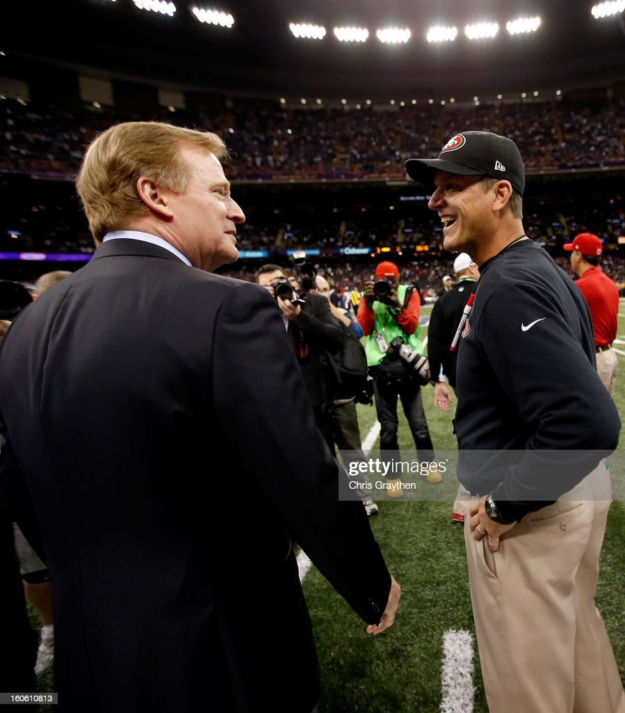 Commissioner Roger Goodell (L) speaks with head coach Jim Harbaugh of the San Francisco 49ers prior to Super Bowl XLVII between the San Francisco 49ers and Baltimore Ravens at the Mercedes-Benz Superdome on February 3, 2013 in New Orleans, Louisiana.
