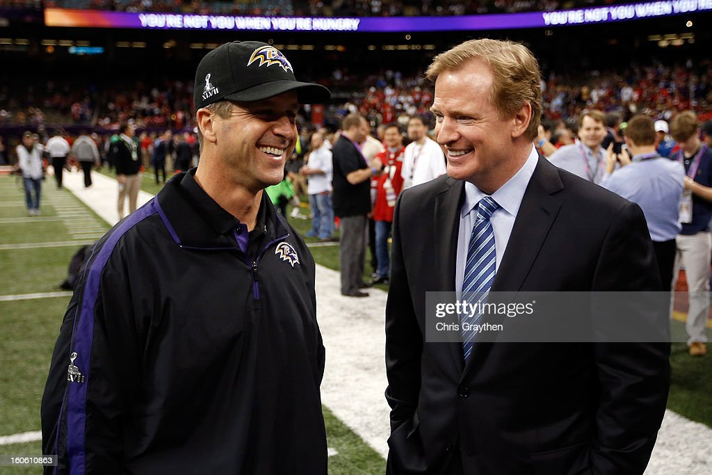 Commissioner Roger Goodell (R) speaks with head coach John Harbaugh of the Baltimore Ravens prior to Super Bowl XLVII between the San Francisco 49ers and Baltimore Ravens at the Mercedes-Benz Superdome on February 3, 2013 in New Orleans, Louisiana.