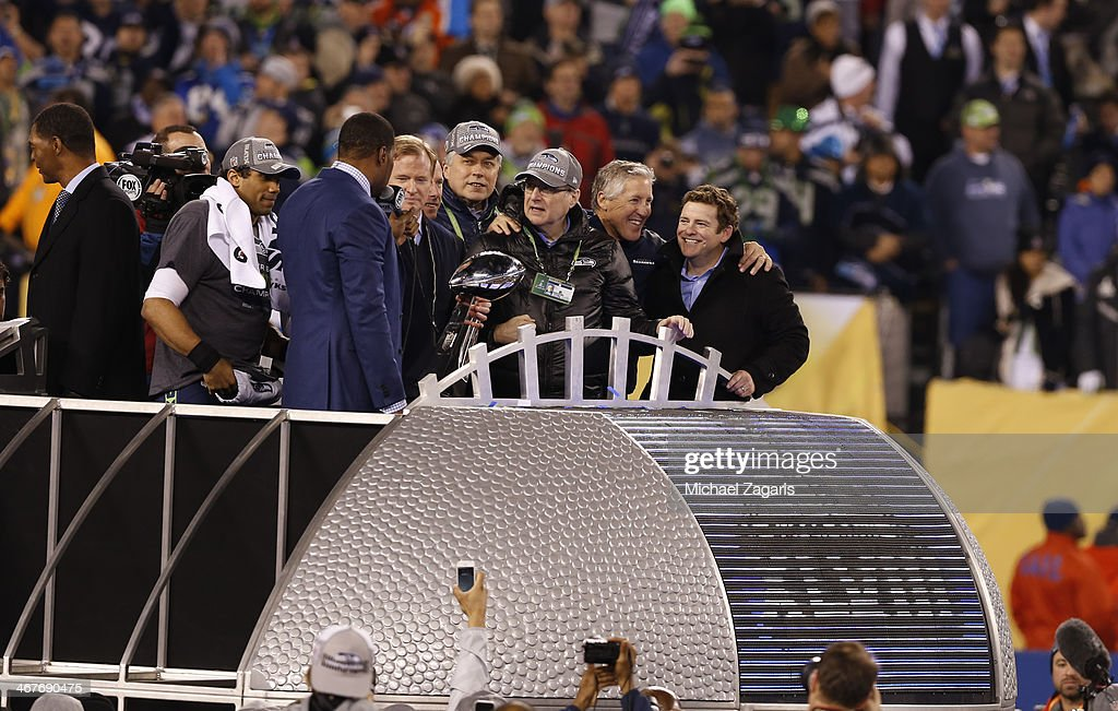 Commissioner Roger Goodell stands with Owner Paul Allen of the Seattle Seahawks and Head Coach Pete Carroll during the trophy ceremony following Super Bowl XLVIII against the Denver Broncos at MetLife Stadium on February 2, 2014 in East Rutherford, New Jersey.