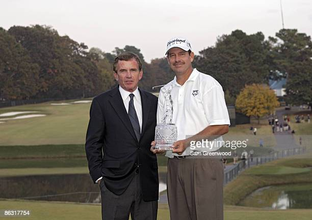 Commissioner Tim Finchem and Bart Bryant after winning THE TOUR Championship at East Lake Golf Club in Atlanta Georgia on November 6 2005
