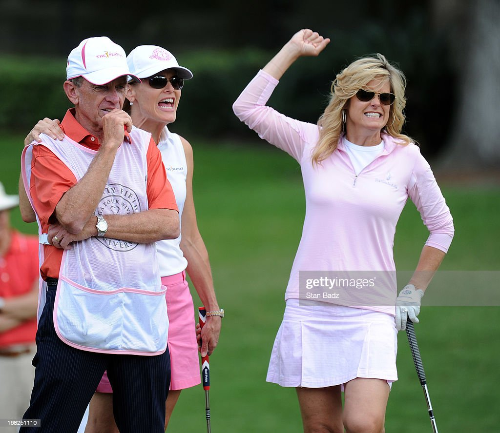 Commissioner Tim Finchem, Holly Fichem, and Tabitha Furyk celebrate their team's birdie putt on the seventh hole during PGA TOUR Wives Classic held on the Dye's Valley course at TPC Sawgrass on May 7, 2013 in Ponte Vedra Beach, Florida.