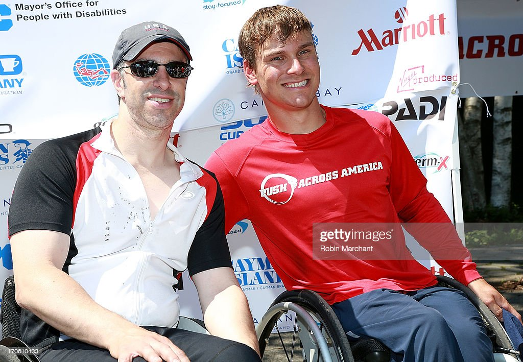 Commissioner Victor Calise (L) and Paralympian Ryan Chalmers attend the 3,000 Mile Push Across America Benefitting Disabled Scuba Diving In the Cayman Islands on June 15, 2013 in New York City.