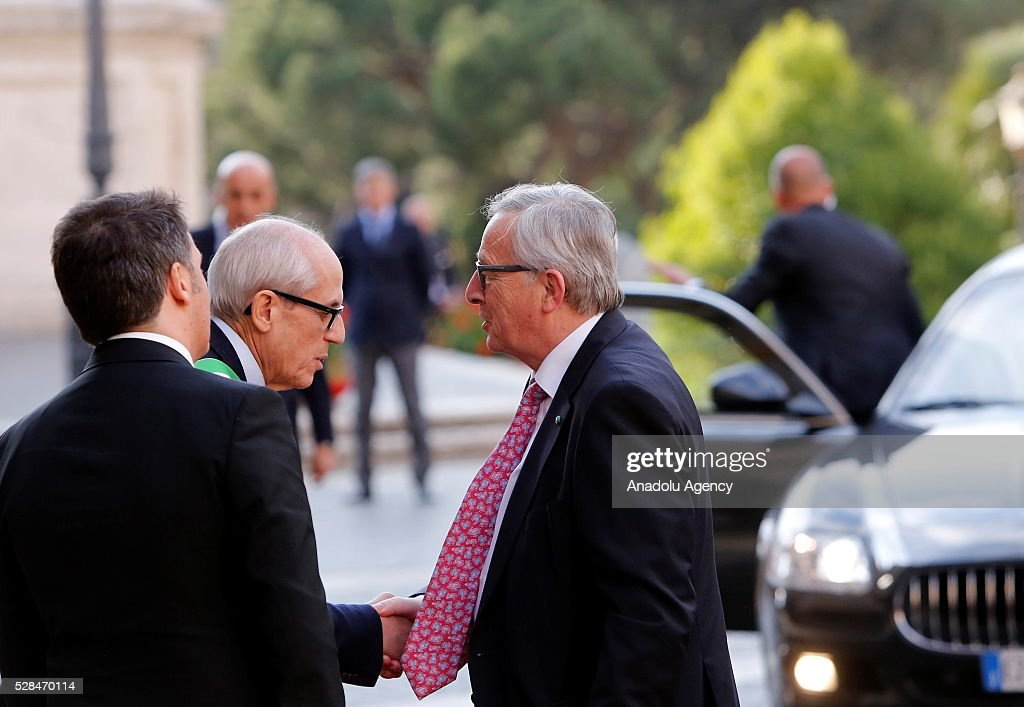 EU Commission's president Jean-Claude Juncker (R) is welcomed by Rome's Commissioner Francesco Paolo Tronca (C) as he arrives in Piazza del Campidoglio to attend a conference on the state of the European Union at the Capitoline Museum in Rome, May 5, 2016.