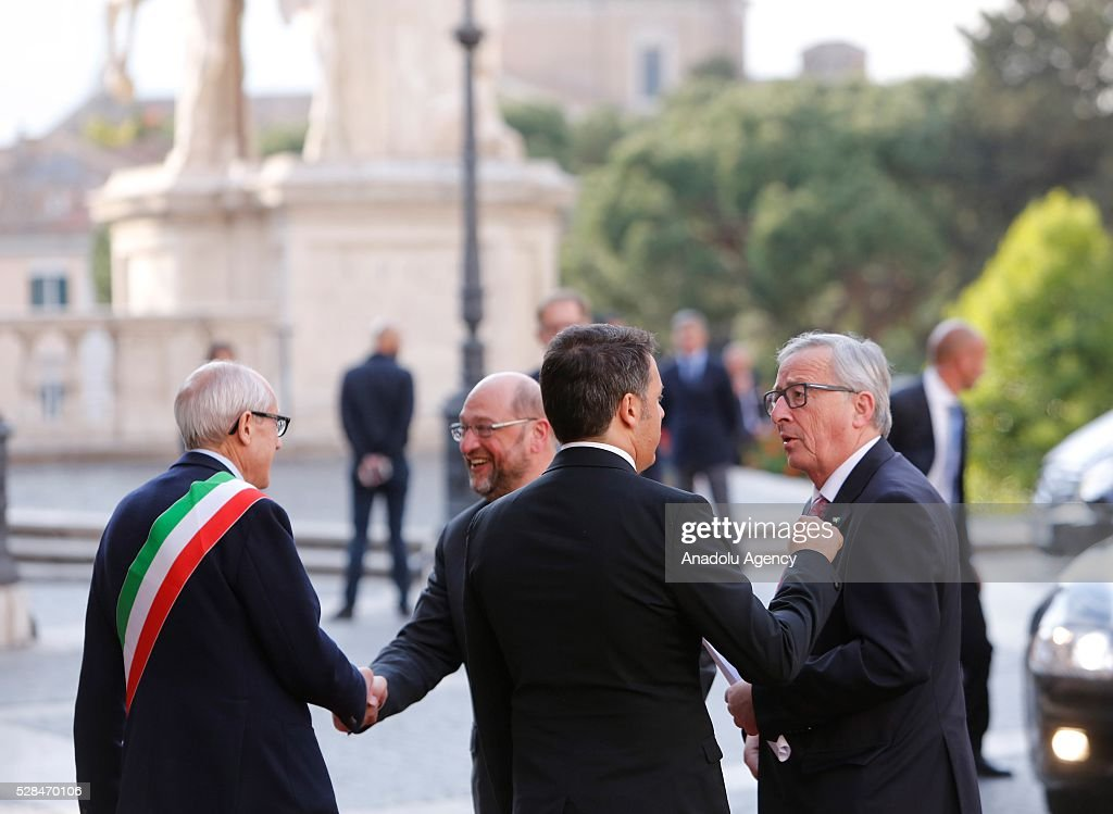 EU Commission's president Jean-Claude Juncker (R) listens to Italian Prime Minister Matteo Renzi (2R) as Rome's Commissioner Francesco Paolo Tronca (L) welcomes EU Parliament's speaker Martin Schulz, as they arrive in Piazza del Campidoglio to attend a conference on the state of the European Union at the Capitoline Museum in Rome, May 5, 2016.