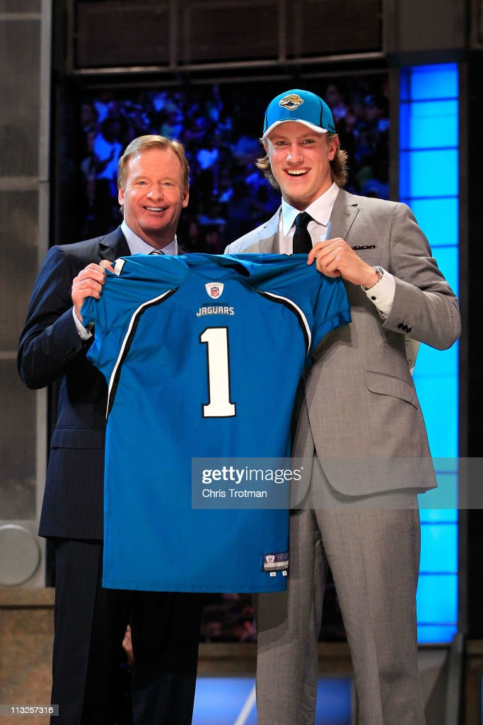 Commissoner <a gi-track='captionPersonalityLinkClicked' href=/galleries/search?phrase=Roger+Goodell&family=editorial&specificpeople=744758 ng-click='$event.stopPropagation()'>Roger Goodell</a> (L) poses for a photo with Blaine Gabbert, #11 overall pick by the Jacksonville Jaguars, holds up a jersey during the 2011 NFL Draft at Radio City Music Hall on April 28, 2011 in New York City.