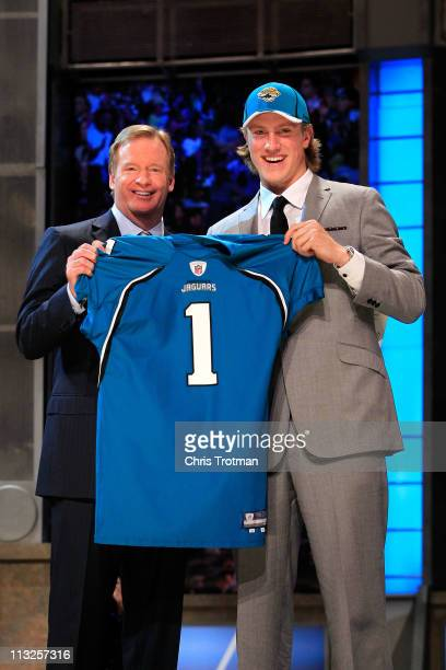 Commissoner Roger Goodell poses for a photo with Blaine Gabbert #11 overall pick by the Jacksonville Jaguars holds up a jersey during the 2011 NFL...