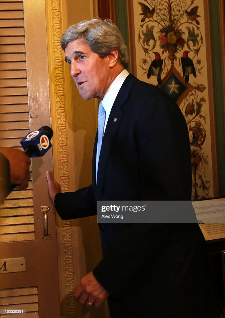Committee Chairman and U.S. Sen. <a gi-track='captionPersonalityLinkClicked' href=/galleries/search?phrase=John+Kerry&family=editorial&specificpeople=154885 ng-click='$event.stopPropagation()'>John Kerry</a> (D-MA) speaks to the press as he arrives after a mark up hearing before Senate Foreign Relations Committee to vote on the nomination of Kerry to be secretary of State January 29, 2013 on Capitol Hill in Washington, DC. The Senate panel has approved the nomination and it is expected the full Senate will pick up the vote today to confirm the nomination to succeed Hillary Clinton.