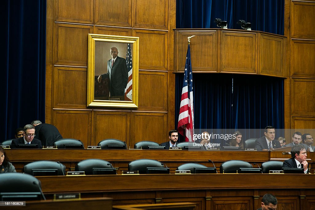 Committee Chairman Darrell Issa (R-CA), far right, gives opening statements while most of the Democratic members' seats were still empty at the start of a House Oversight Committee hearing entitled 'Reviews of the Benghazi Attack and Unanswered Questions,' in the Rayburn House Office Building on Capitol Hill, September 19, 2013 in Washington, DC. Committee Chairman Darrell Issa (R-CA) is continuing to lead the GOP investigation of the Sept. 11, 2012, assaults that killed U.S. Ambassador J. Christopher Stevens and three other Americans at the U.S. Consulate in Benghazi, Libya.