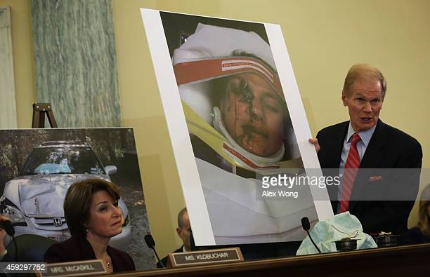 Committee Chairman Sen Bill Nelson holds up a photo of Stephanie Erdman of Destin Florida of her face injury by the airbag explosion in her Honda...
