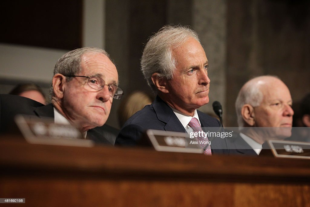 Committee chairman Sen. <a gi-track='captionPersonalityLinkClicked' href=/galleries/search?phrase=Bob+Corker&family=editorial&specificpeople=3986296 ng-click='$event.stopPropagation()'>Bob Corker</a> (R-TN) (C), ranking member Sen. <a gi-track='captionPersonalityLinkClicked' href=/galleries/search?phrase=Ben+Cardin&family=editorial&specificpeople=2302501 ng-click='$event.stopPropagation()'>Ben Cardin</a> (D-MD) (R) and Sen. James Risch (R-ID) (L) listen during a hearing before the Senate Foreign Relations Committee July 23, 2015 on Capitol Hill in Washington, DC. The committee is reviewing the proposed Iran nuclear agreement.