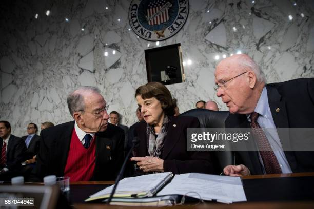 Committee chairman Sen Chuck Grassley ranking member Sen Dianne Feinstein and Sen Patrick Leahy talk with each other during a Senate Judiciary...
