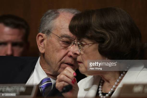 Committee Chairman Sen Chuck Grassley talks to ranking member Sen Dianne Feinstein during the confirmation hearing of FBI Director nominee...