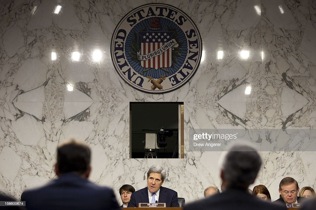 Committee Chairman Sen. <a gi-track='captionPersonalityLinkClicked' href=/galleries/search?phrase=John+Kerry&family=editorial&specificpeople=154885 ng-click='$event.stopPropagation()'>John Kerry</a> (D-MA) (C) questions witnesses Deputy Secretary of State William Burns (R) and Deputy Secretary of State for Management and Resources Thomas Nides during the Senate Foreign Relations Committee hearing on the September 11th attacks on the U.S. Consulate in Benghazi, on Capitol Hill, December 20, 2012 in Washington, DC. Secretary of State Hillary Clinton had planned to testify at the hearing, but could not attend due to an illness.