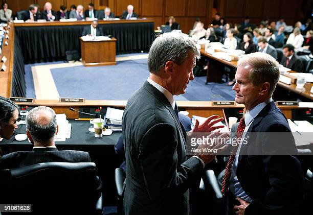 Committee Chairman Sen Max Baucus talks to Sen Bill Nelson during a mark up hearing before the US Senate Finance Committee on Capitol Hill September...
