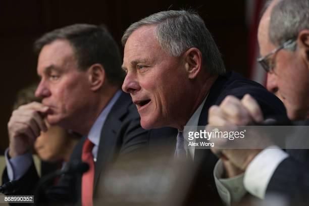 Committee Chairman Sen Richard Burr speaks as Committee Vice Chairman Sen Mark Warner listens during a hearing before the Senate Intelligence...