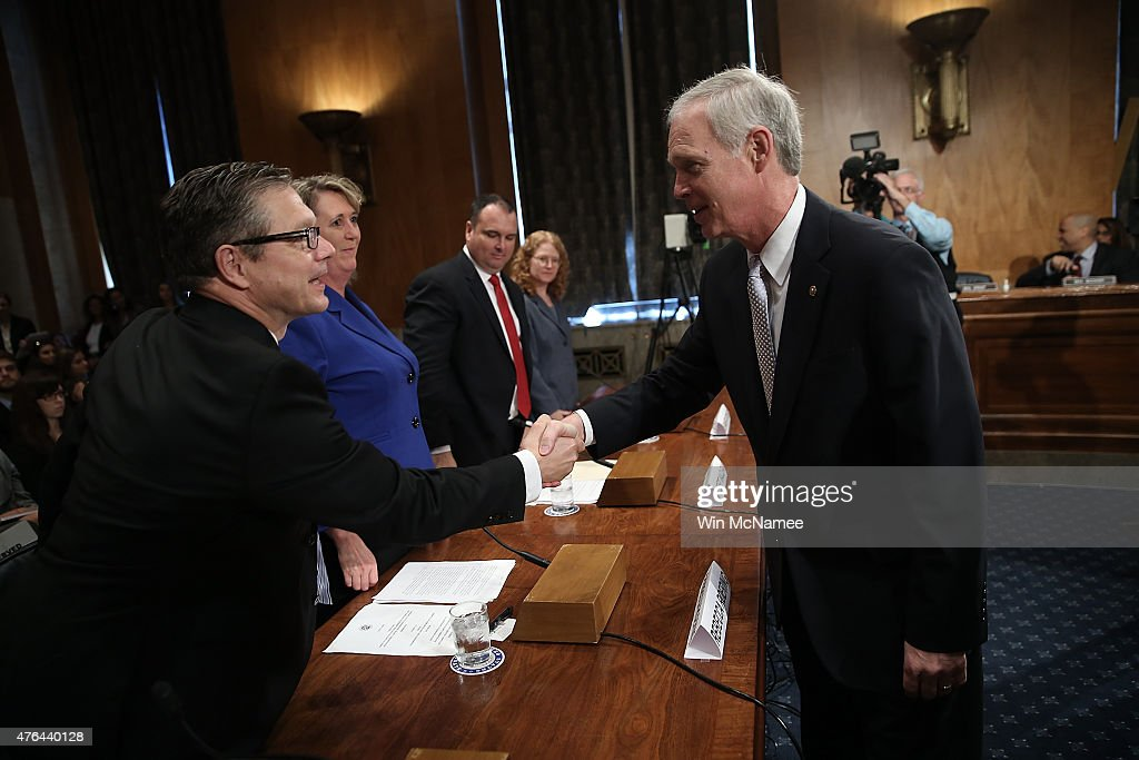 Committee Chairman Sen. Ron Johnson (R) (R-WI) greets Homeland Security Inspector General John Roth (L) prior to Roth testifying before the Senate Homeland Security and Governmental Affairs Committee June 9, 2015 in Washington, DC. The committee heard testimony on 'Oversight of the Transportation Security Administration: First-Hand and Government Watchdog Accounts of Agency Challenges.' Also pictured (L-R) are Rebecca Roering, assistant federal TSA security director for the Minneapolis-St. Paul International Airport; Robert MacLean, federal air marshal in the Federal Air Marshal Service's Los Angeles Field Office; and Jennifer Grover, director for transportation security and coast guard issues in the Government Accountability Office's Homeland Security and Justice Team.