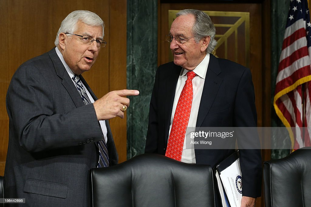 Committee chairman Sen. <a gi-track='captionPersonalityLinkClicked' href=/galleries/search?phrase=Tom+Harkin&family=editorial&specificpeople=211373 ng-click='$event.stopPropagation()'>Tom Harkin</a> (D-IA) (R) talks to ranking member Sen. Michael Enzi (R-WY) prior to a hearing before the Senate Health, Education, Labor and Pensions Committee November 15, 2012 on Capitol Hill in Washington, DC. The hearing was focused on the meningitis outbreak originating at a Massachusetts pharmacy that has killed 32 people and sickened 461 more.