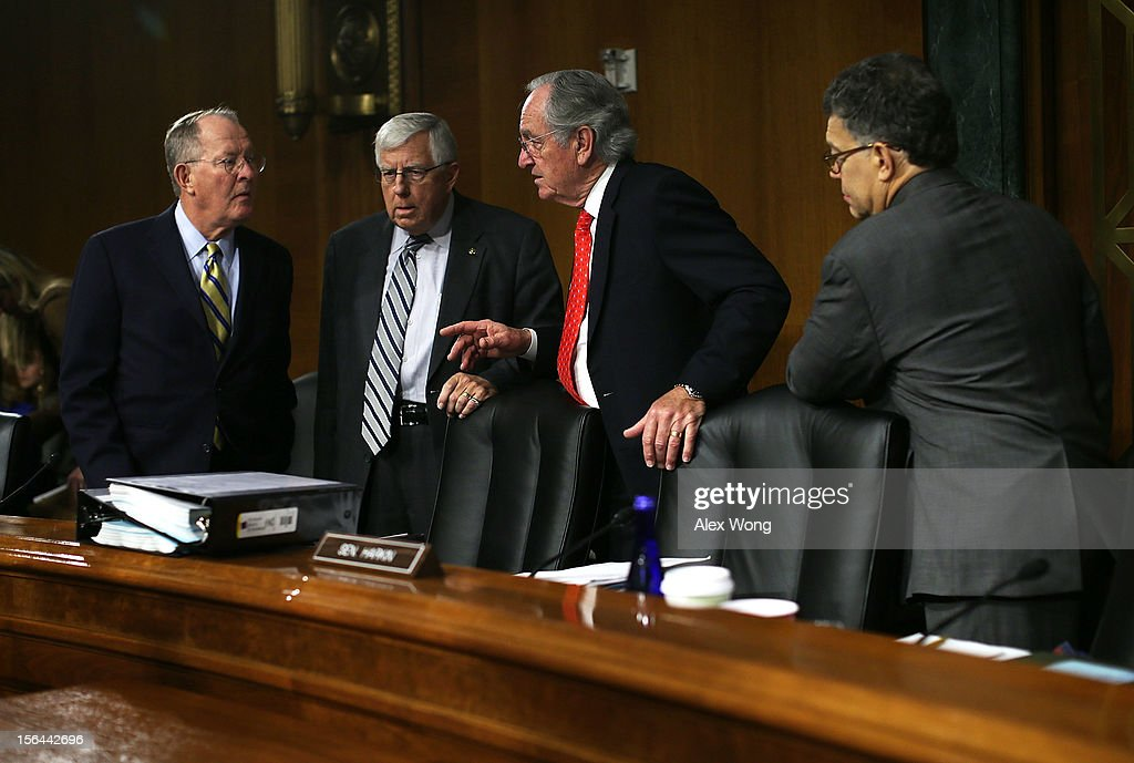 Committee chairman Sen. <a gi-track='captionPersonalityLinkClicked' href=/galleries/search?phrase=Tom+Harkin&family=editorial&specificpeople=211373 ng-click='$event.stopPropagation()'>Tom Harkin</a> (D-IA) (2nd R) talks to ranking member Sen. Michael Enzi (R-WY) (2nd L) as Sen. <a gi-track='captionPersonalityLinkClicked' href=/galleries/search?phrase=Al+Franken&family=editorial&specificpeople=167079 ng-click='$event.stopPropagation()'>Al Franken</a> (D-MN) (R) looks on prior to a hearing before the Senate Health, Education, Labor and Pensions Committee November 15, 2012 on Capitol Hill in Washington, DC. The hearing was focused on the meningitis outbreak originating at a Massachusetts pharmacy that has killed 32 people and sickened 461 more.