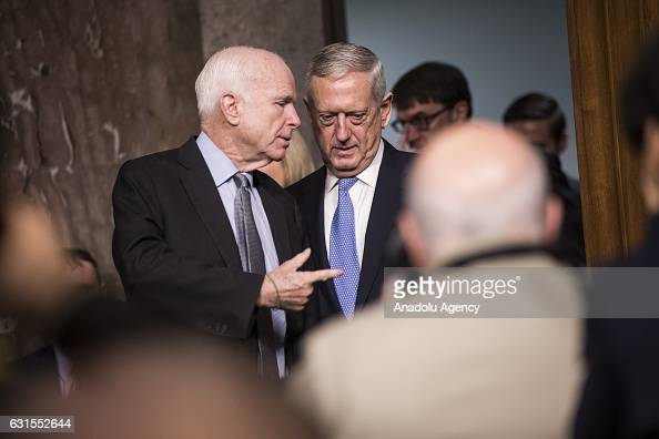 Committee Chairman Senator John McCain speaks with retired Marine Corps General James Mattis as he arrives to testify before the Senate Armed...