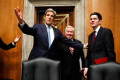 Committee Chairman US Sen John Kerry shows British Secretary of State for Foreign and Commonwealth Affairs David Miliband his seat as Sen Richard...