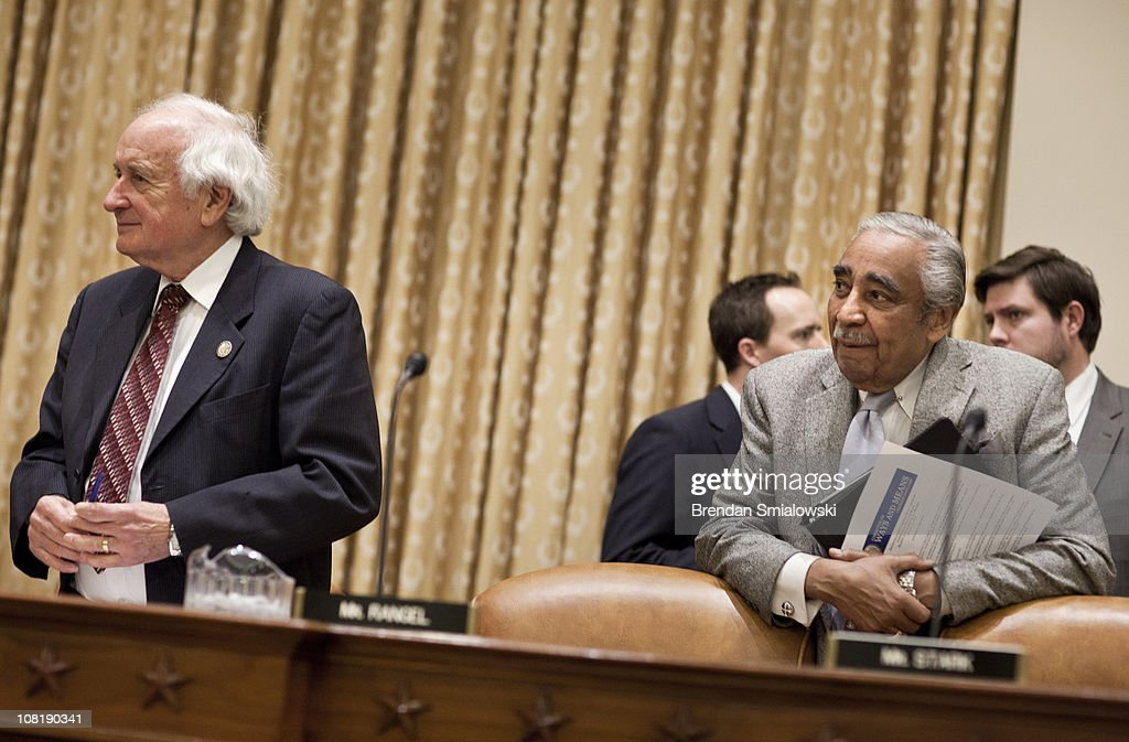 Committee ranking member Rep. Sander Levin (D-MI) (L) and former committee chairman Rep. Charlie Rangel (D-NY) wait for the start of the 112th Congress's first hearing of the House Ways and Means Committee on Capitol Hill January 20, 2011 in Washington, DC. The Committee called business and tax leaders to testify about the effect of the Federal income tax on tax payers and the economy.
