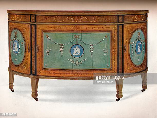 Commode of Lunette Form circa 1775 Commode of Lunette Form Inlaid with East India Satinwood and Borders of Harewood and Tulipwood Ornamented with...