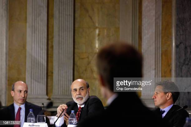 Commodity Futures Trading Commission Chairman Gary Gensler Federal Reserve Chairman Ben Bernanke and Treasury Secretary Timothy Geithner participate...