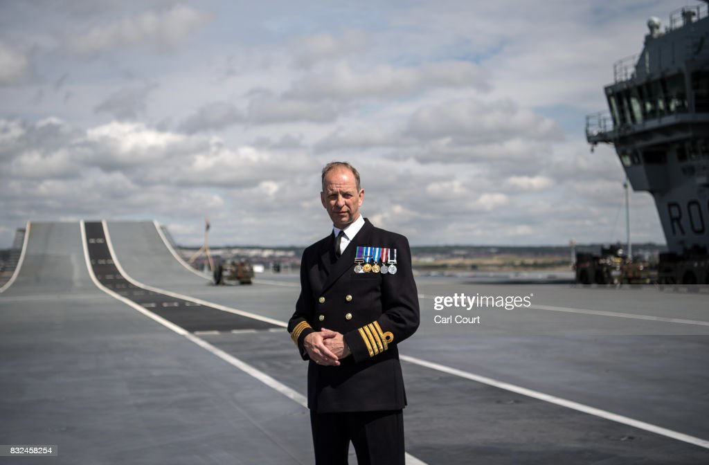 Commodore Jerry Kyd, the captain of HMS Queen Elizabeth, poses for a photograph on the flight deck shortly after the ship's arrival in Portsmouth Naval Docks on August 16, 2017 in Portsmouth, England. HMS Queen Elizabeth is the lead ship in the new Queen Elizabeth class of supercarriers. Weighing in at 65,000 tonnes she is the largest warship deployed by the British Royal Navy. She is planned to be in service by 2020 and with a second ship, HMS Prince of Wales, to follow.