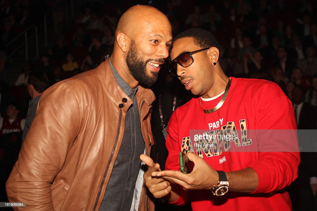 Common and Ludacris talk during the 2013 NBA All-Star Game during All Star Weekend on February 17, 2013 at the Toyota Center in Houston, Texas.
