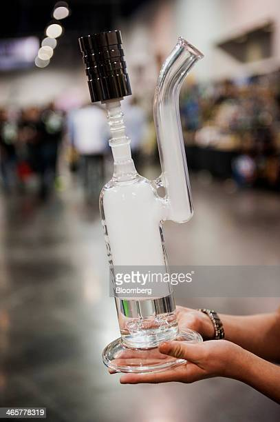 A Common Ground electronic hookah is displayed during the Champs Trade Show in Las Vegas Nevada US on Tuesday Jan 21 2014 Champs is a...