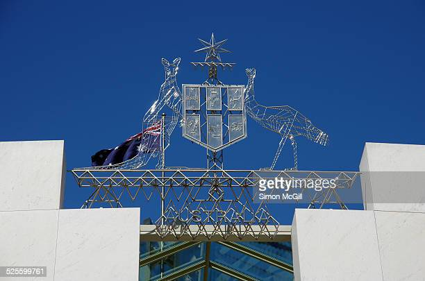 Commonwealth Coat of Arms the formal symbol of the Commonwealth of Australia above the main entrance to Parliament House Canberra Australian Capital...