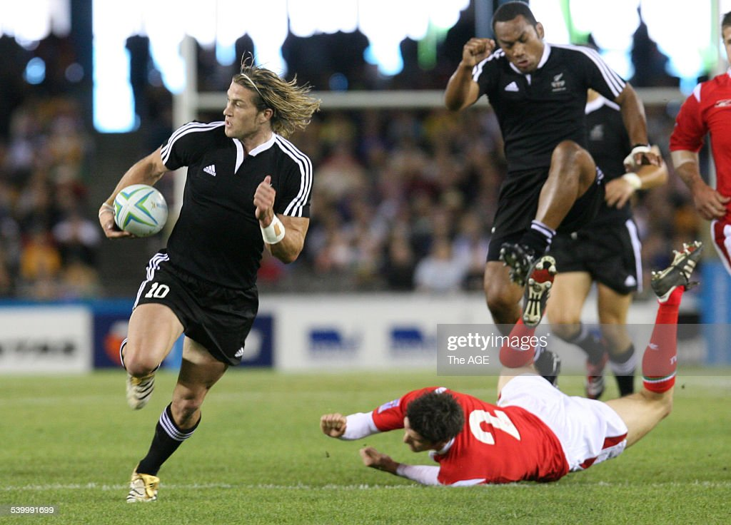 Commonwealth Games 2006 New Zealand's Cory Jane powers past Wales' James Hook during the Rugby Sevens competition at the Telstra Dome Melbourne...